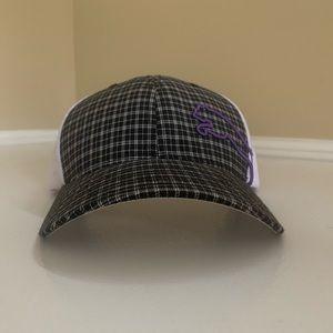 White and Black check puma hat.  Purple logo.